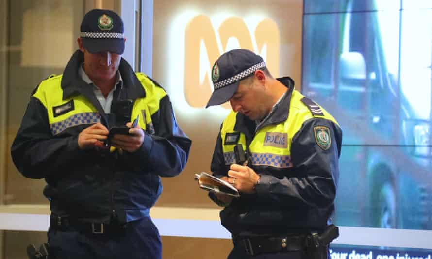 Two police officers outside the ABC building in Sydney.
