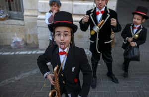 Children in Jerusalem. The carnival-like Purim holiday is usually celebrated with parades and costume parties to commemorate the biblical story of the deliverance of the Jewish people from a plot to exterminate them in the ancient Persian empire, as recorded in the Book of Esther
