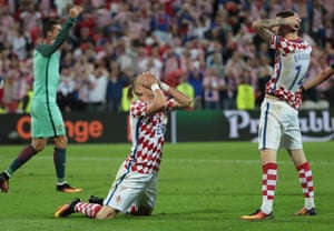 Croatia's Marcelo Brozovic (right) and Domagoj Vida react after losing in extra time to Portugal