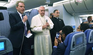 The pope aboard his plane as he flies back from Peru. He said of Bishop Juan Barros: 'I can't condemn him because I don't have evidence.'