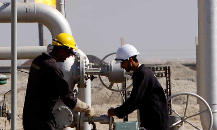 Oil workers work at the West Qurna Phase 2 field in the Basra region.