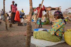 Markom Malima from Uganda sells clothes at a market in Bidi Bidi,