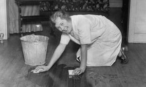 Housewife scrubbing floor