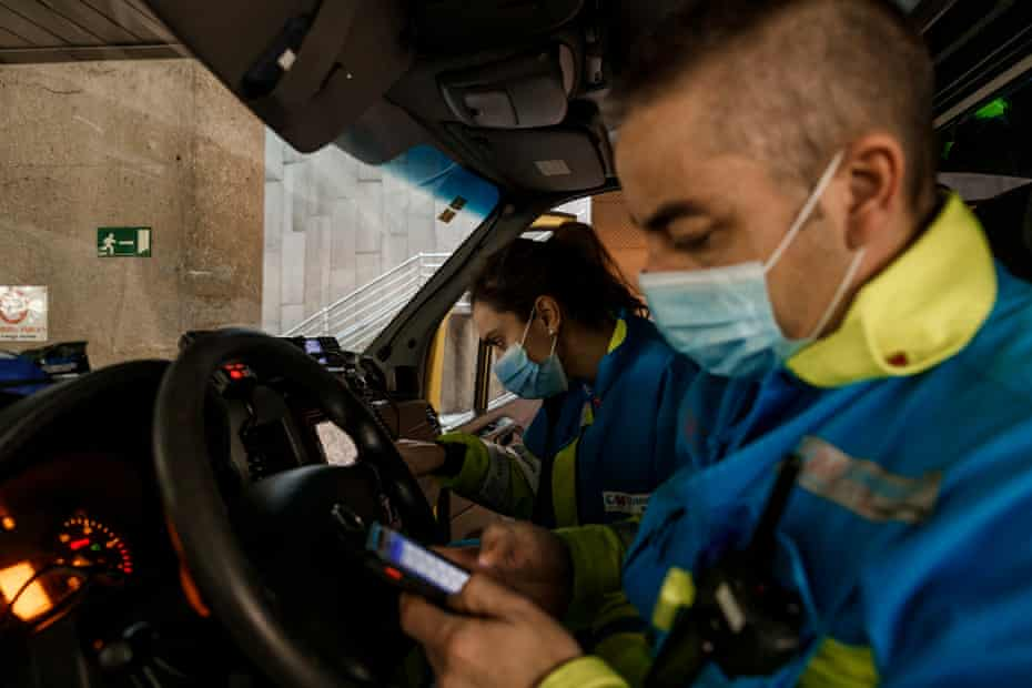 Javier, a technician at UVI5 and Coll type in an address into the ambulance's satnav before heading off.