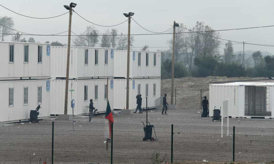 The repurposed containers housing minors in the Calais camp.