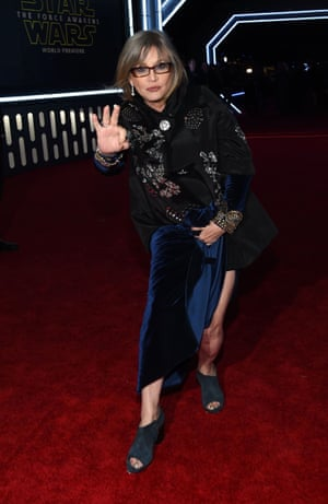 Carrie Fisher, known as Princess Leia, shows off her blue suede shoes.