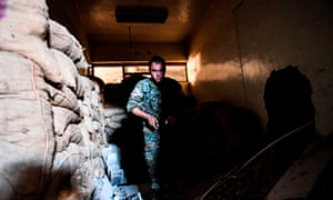 An SDF fighter inspects a tunnel under the municipal stadium