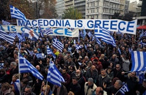 Protesters hold a banner saying Macedonia is Greece as they march in Athens