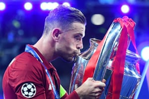 Liverpool's Jordan Henderson celebrates with the trophy.