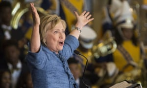 Hillary Clinton raises her arms after speaking at the Louisiana Leadership Institute in Baton Rouge.