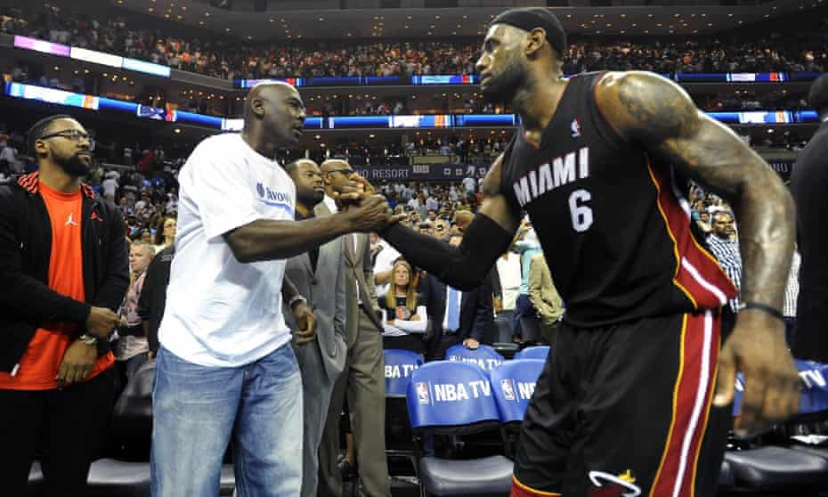 Michael Jordan and LeBron James greet each other during James's time with the Miami Heat in 2014