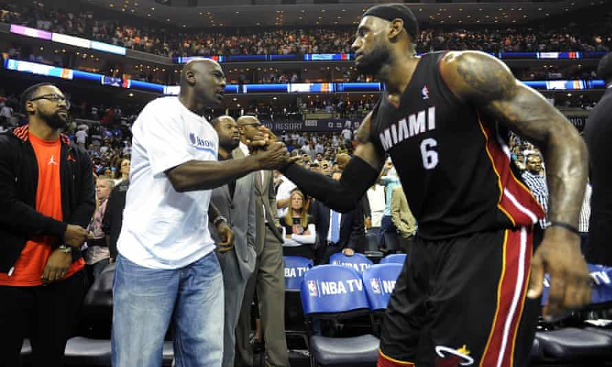 Michael Jordan shakes hands with LeBron James during the latter's time with the Miami Heat in 2014