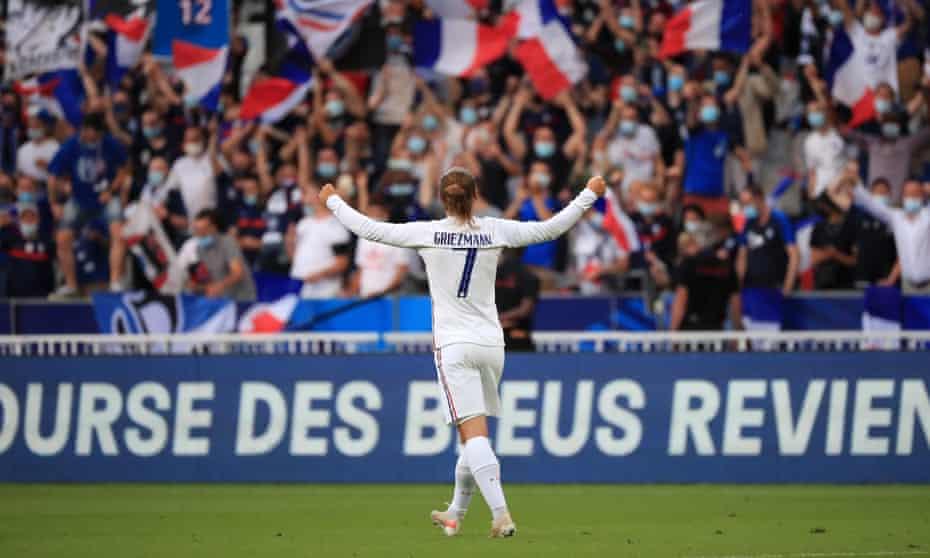 Antoine Griezmann celebrates a goal against Bulgaria with fans at the Stade de France.