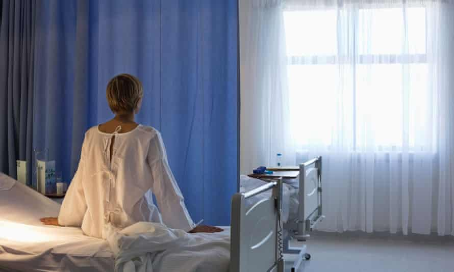 Woman on hospital bed