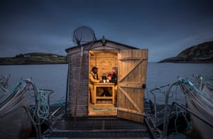 'Night Watch at Salmon Farm'Euan Myles Daniel (left) travelled from Nigeria to the northwest of Scotland to fulfil his dream of working as a marine biologist. It is one of the wildest and wettest parts of the UK but he has fallen in love with the area and plans to stay.