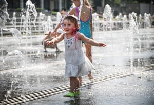 Children play in the capital's fountains