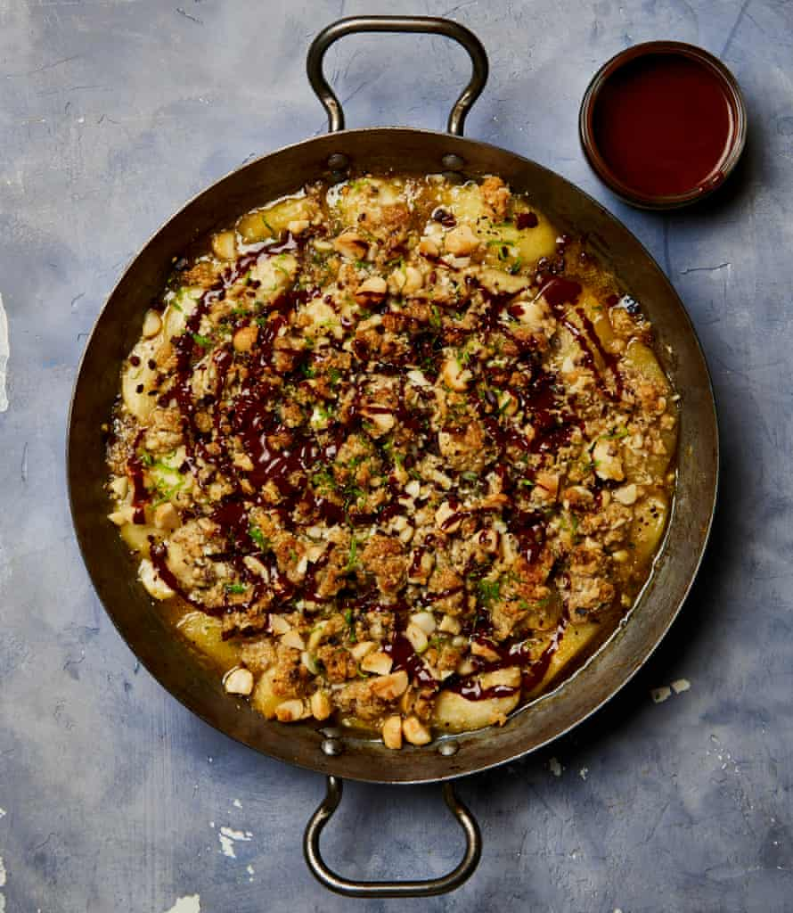 Yotam Ottolenghi's pear and macadamia crumble with chocolate sauce.