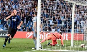Atalanta's Andrea Masiello celebrates after opening the scoring.