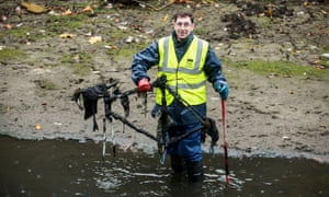 A volunteer helping clean up a 1km stretch of Regents Canal near Salmon Lane Lock, London