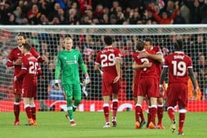 Dejan Lovren plants a kiss on James Milner as Liverpool celebrate after the match.