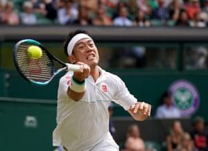 Kei Nishikori in action against Roger Federer.