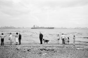 People line up at the sea shore in New Brighton in 1979
