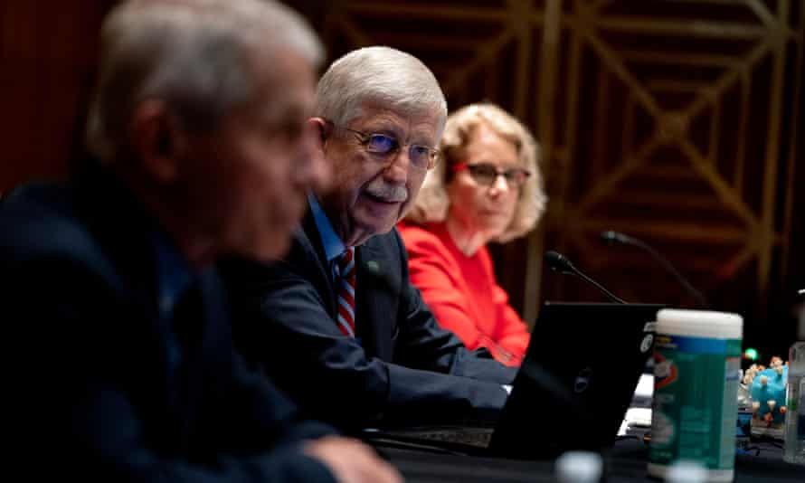 Dr Francis Collins, director of the US National Institutes of Health (NIH), center, speaks during a Senate hearing in Washington on 26 May 2021.