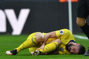 Giroud lies injured after having another effort disallowed.