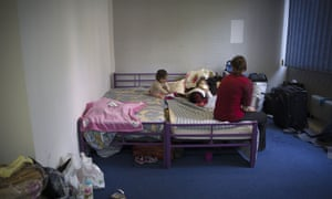 A women with her children in an emergency shelter.
