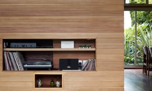A pine half wall built to house a TV and hi-fi.