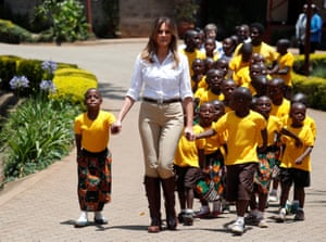 Children flock to hold her hand during a visit to The Nest Children's Home near Nairobi.