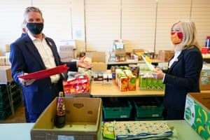Pontefract, UK. The Labour leader, Sir Keir Starmer, and Tracy Brabin, the MP for Batley and Spen and West Yorkshire mayoral candidate, help out at a food bank during their campaign