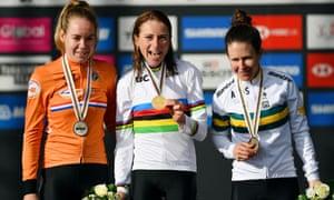 Silver medal winner Anna Van Der Breggenl (left), Gold medal winner Annemiek Van Vleuten and Bronze medal winner Amanda Spratt (right) celebrate on the podium.