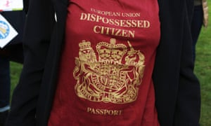 An anti-Brexit protester wearing a T-shirt styled as a UK passport saying  'dispossessed citizen'.