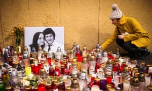 Candles are placed in front of a photo of Ján Kuciak and his fiancée, Martina Kušnírová, who was also killed.