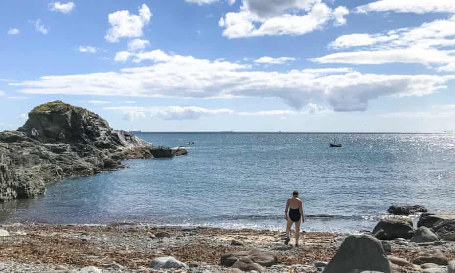 A swimmer on the beach at Cadgwith, Cornwall.