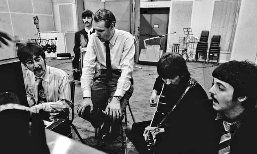 George Martin with the Beatles at Abbey Road.