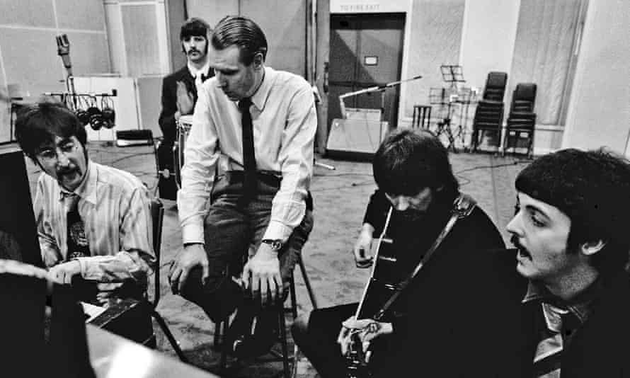 'Suave persona': George Martin with the Beatles at Abbey Road during the Sgt Pepper's sessions in January 1967.