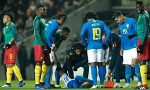 Neymar lies injured and has to go off early in the game Brazil won against Cameroon on Tueasday night.