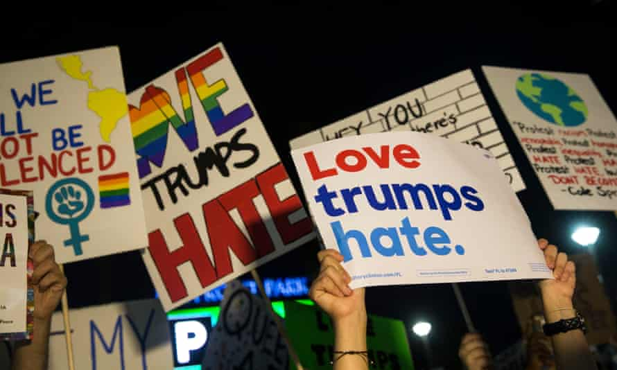 People protest Donald Trump in Miami. As his coming victory became clear, the number of calls to a suicide prevention hotline surged.