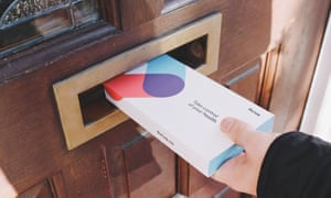 A hand putting a Thriva health test through a letterbox