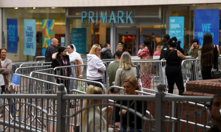 Shoppers queue outside a Primark store in Stoke-on-Trent.
