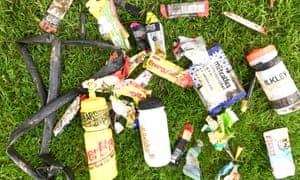 Discarded gel packets littering the grass after a race.