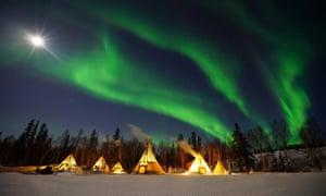 PR Aurora-Village-Yellowknife-Northwest-Territories-Canada-Aurora-Borealis-Northern-Lights-winter-blue-sky-light-teepees