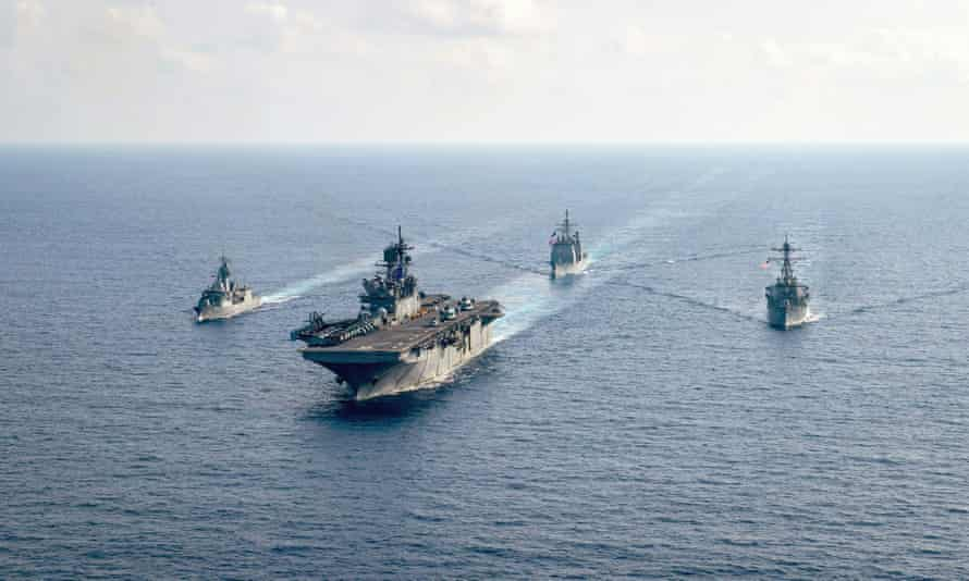 The Royal Australian Navy guided-missile frigate HMAS Parramatta, left, underway with US Navy ships in the South China Sea in April.