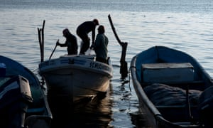 Migrant boats often stop at fishing villages to refill petrol tanks