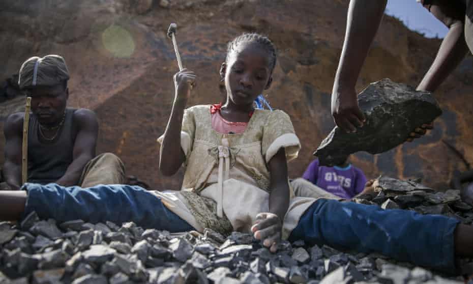 Irene Wanzila, 10, works breaking rocks with a hammer