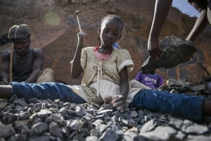 Ten-year-old Irene Wanzila breaks rocks with a hammer along with her younger brother, older sister and mother, who says she was left without a choice after she lost her cleaning job at a private school when coronavirus pandemic restrictions were imposed at Kayole quarry.