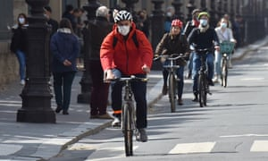 People ride in a cycle lane in Paris