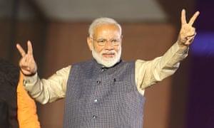 Narendra Modi celebrates at his party headquarters in New Delhi.